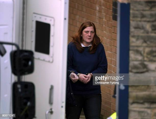 A handcuffed Karen Matthews the mother of Shannon Matthews leaves Dewsbury Police Station today to appear at court charged with perverting the course...