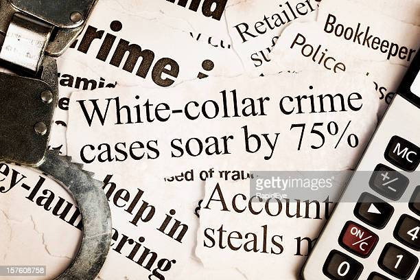 Handcuffs and calculator on headlines about white collar crime