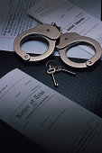 Handcuffs , handcuff keys , notice of trial and other legal papers