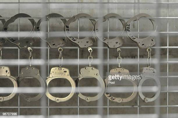 Handcuffs hang in Camp 6 highsecurity detention facility April 27 2010 at Guantanamo Bay US Naval Base Cuba Today a military tribunal began hearings...