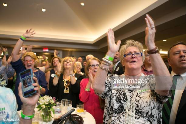 Handel supporters including Wanda Becker cheer for early results in favor of Georgia's 6th Congressional district Republican candidate Karen Handel...