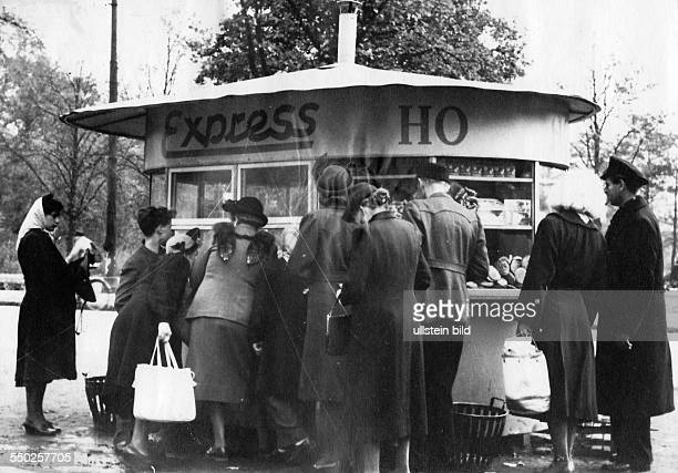 Handelsorganisation setting up national retail business in the Soviet Zone of occupation in Germany people queuing at a snack stall in East Berlin