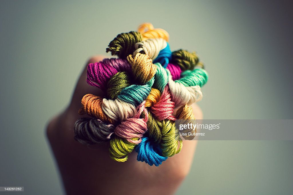 Handful of colorful embroidery floss : Stock Photo