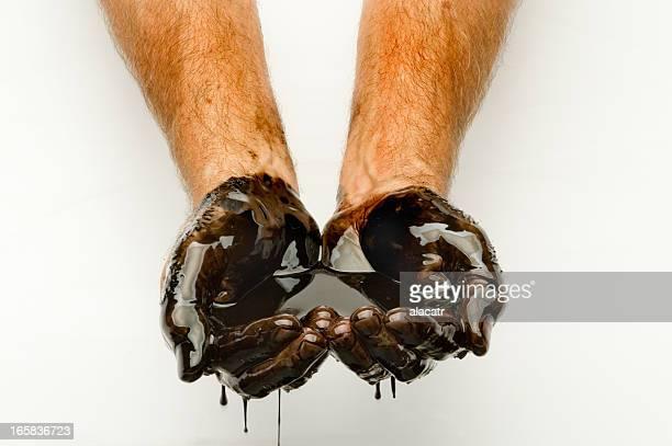Handvoll von Öl