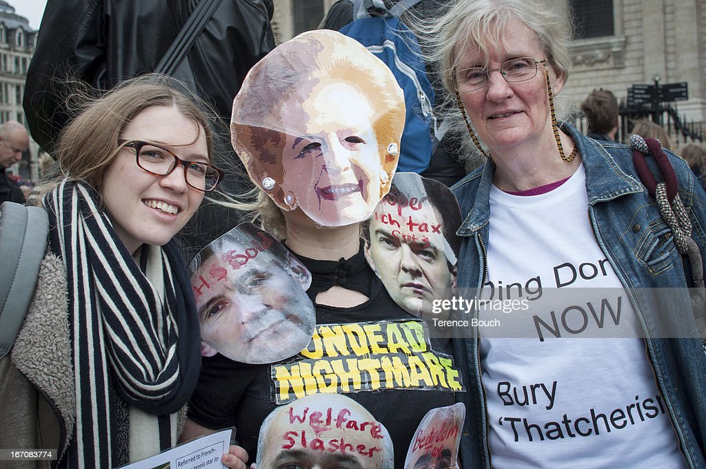 CONTENT] A handful of protestors outside St Paul's Cathedral show their opposition to the ceremonial funeral of Lady Thatcher with one lady wearing a face mask of Margaret Thatcher bearing anti welfare cut messages whilst another wears a t-shirt calling for Thatcherism to now be buried away.