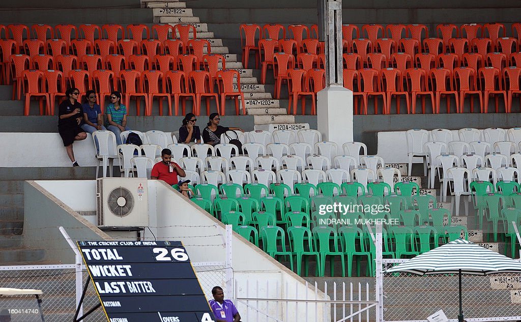 A handfull of Indian spectators sit in empty stands during the inugural match of the ICC Women's World Cup 2013 between India and West Indies at the Cricket Club of India's Brabourne stadium in Mumbai on January 31, 2013. Teams from Australia, England, New Zealand, Pakistan, South Africa, Sri Lanka, West Indies join hosts India for the global event which is being played from 31 January to 17 February. The women's World Cup opened in Mumbai with the cricketers hoping to put aside memories of the unsavoury build-up and gain their due recognition in a country where the men's game reigns supreme. AFP PHOTO/ Indranil MUKHERJEE