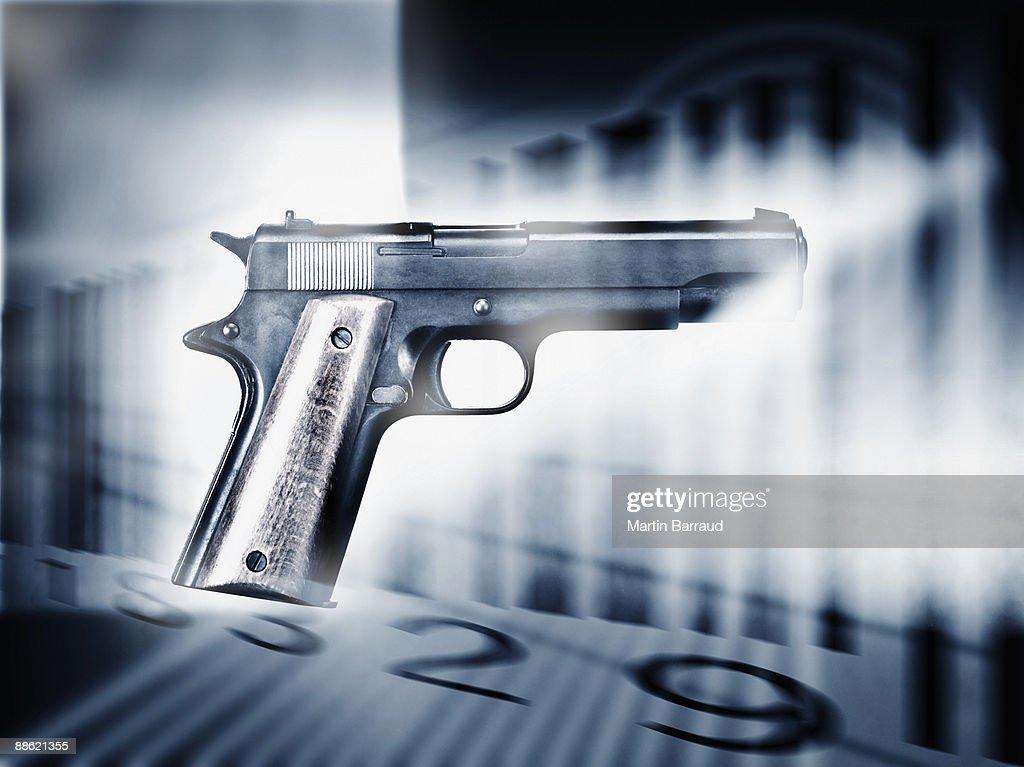 Handgun and bar code : Stock Photo