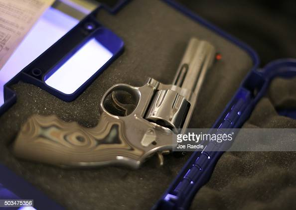 A handgun is seen in its case at the KW Gunworks store on the day that US President Barack Obama in Washington DC announced his executive action on...