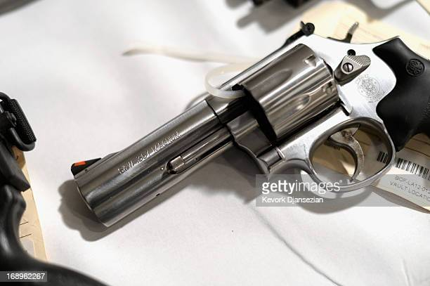 A handgun seized during recent sweeps is shown on display at a news conference on May 17 2013 at the Los Angeles Civic Center in Los Angeles...