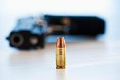 A handgun with ammunition