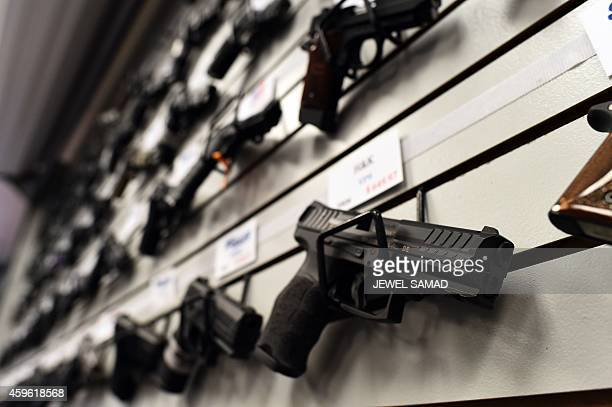 Handguns are displayed at the Ultimate Defense Firing Range and Training Center in St Peters Missouri some 20 miles west of Ferguson on November 26...