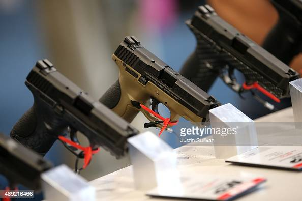 Handguns are displayed during the 2015 NRA Annual Meeting Exhibits on April 10 2015 in Nashville Tennessee The annual NRA meeting and exhibit runs...