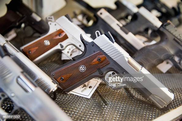 Handguns are offered for sale at Freddie Bear Sports on March 11 2015 in Tinley Park Illinois According to a survey conducted by the University of...