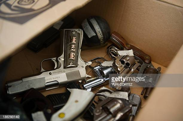 Handguns exchanged by Mexican citizens for money and food are seen piled inside a box on December 8 2011 in Mexico CityThe Secretary of Public Safety...