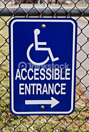 handicap accessible entrance sign stock photo thinkstock