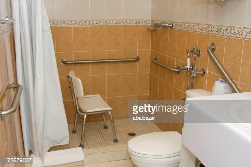 Handicap Accessible Shower With Grab Bars And A Chair Stock Photo Getty Images