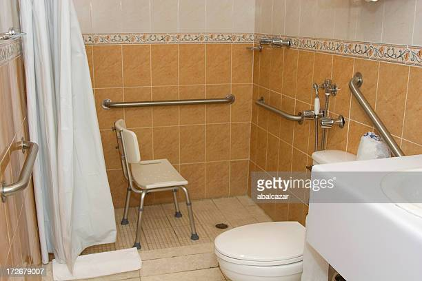 Handicap accessible shower with grab bars and a chair