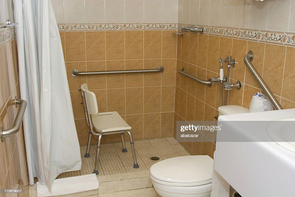 handicap accessible shower with grab bars and a chair stock photo