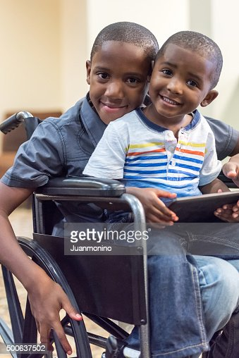 Handicap child playing with his little brother