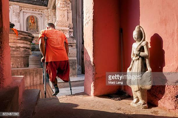 GAYA BIHAR INDIA BODHGAYA BIHAR INDIA Handicaped Buddhist monk in the Mahabodhi Mahavihara temple of Bodhgaya Bihar India
