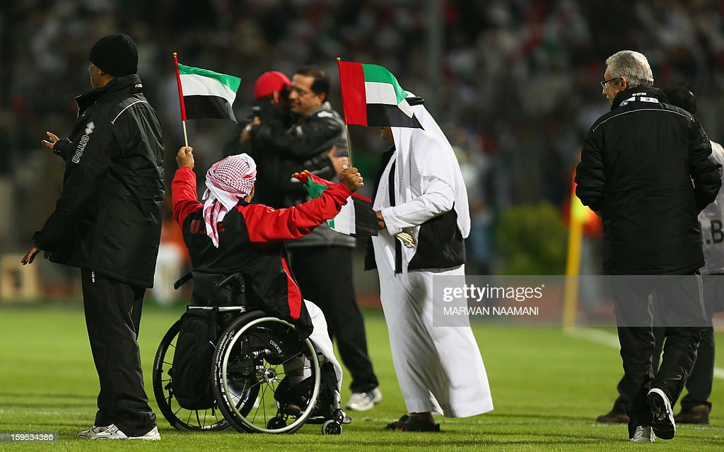 A handicapped Emirati fan waves his country's flag after the United Arab Emirates team beat Kuwait 1-0 during the two teams' semi final match in the 21st Gulf Cup in Manama, on January 15, 2013.