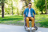 Portrait of handicapped young man in a wheelchair