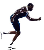 one muscular handicapped man runners sprinters with legs prosthesis in silhouette on white background