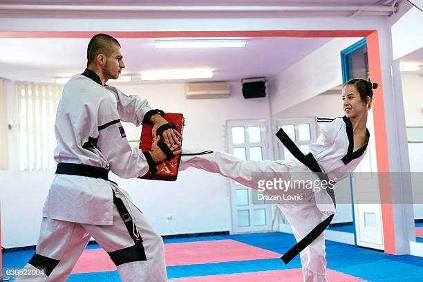 Handicapped martial arts trainee practicing taekwondo