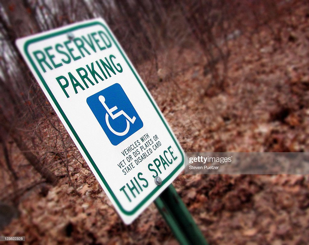 Handicapped reserved parking sign