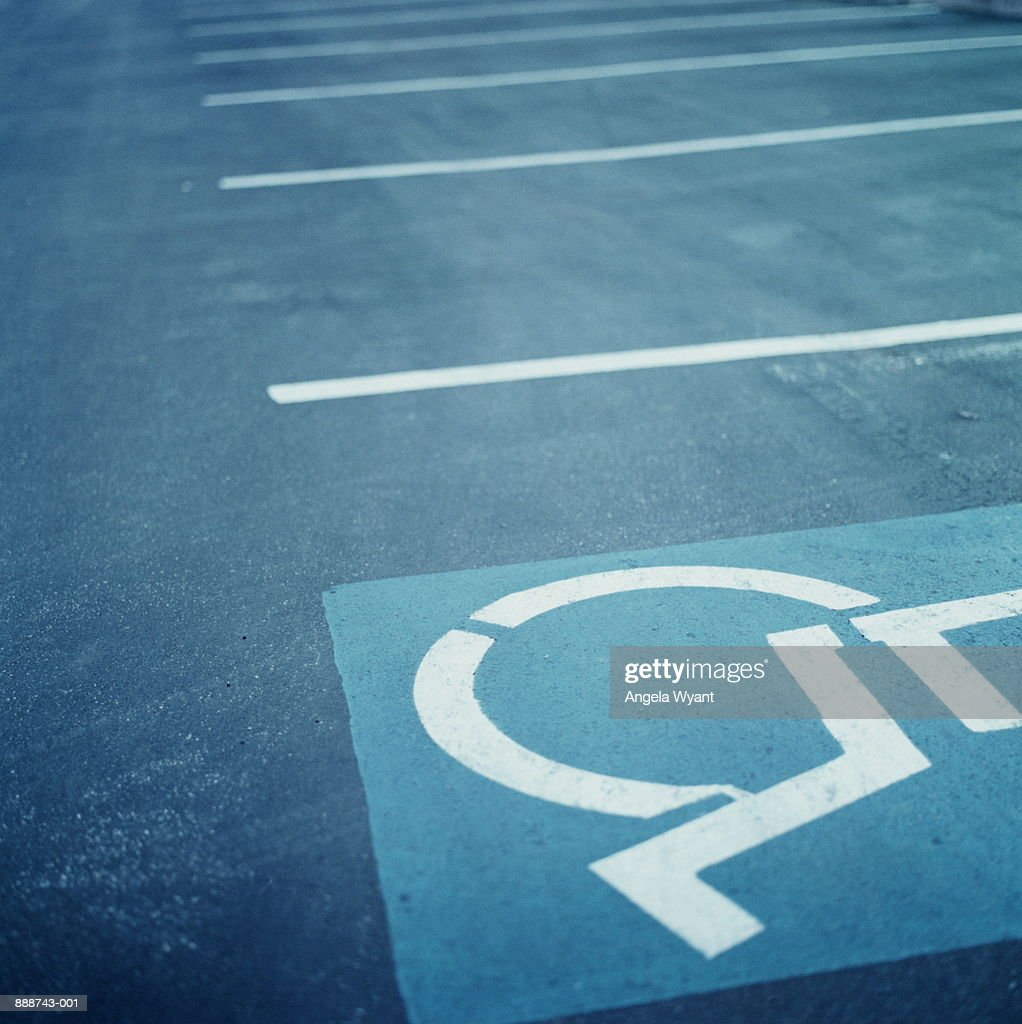 Handicapped symbol on parking zone