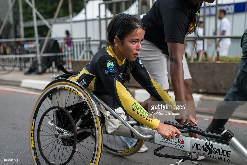 A handicapped woman is seen before the 88th Sao Silvestre international 15 km race in Sao Paulo, Brazil, on 31 December 2012. Twenty-five thousand runners participated in the 15 km traditional New Year's Eve event.