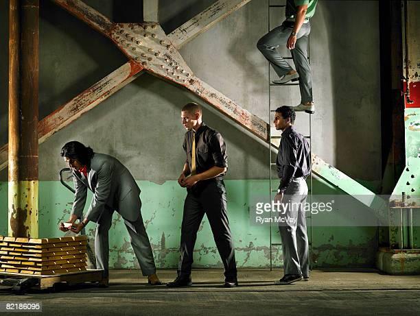 handing bars of gold up a ladder