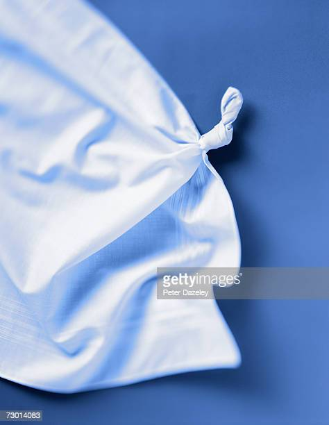 Handkerchief with knot tied in it