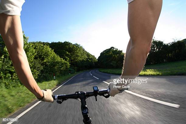 handlebars of bike in country road