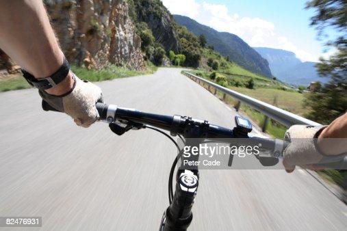 Handlebars of bike in mountain path : Stock Photo