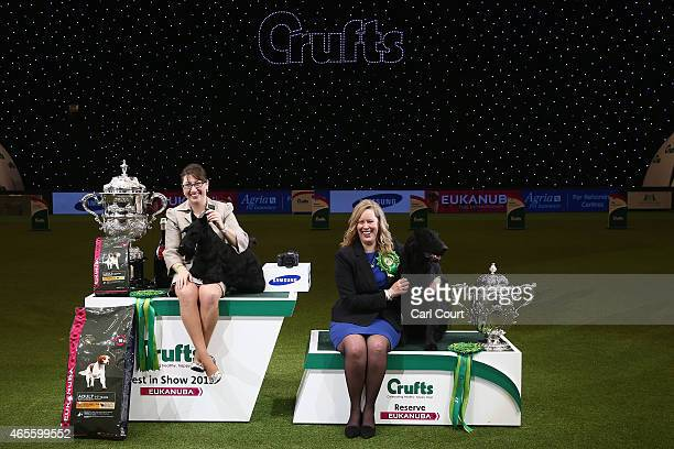 Handler Rebecca Cross with Knopa the Scottish Terrier celebrate winning the Best in Show category alongside Reserve winner Owner Anette Dyren and...