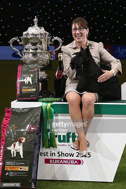 Handler Rebecca Cross with Knopa the Scottish Terrier celebrate winning the Best in Show category of Crufts 2015 on the fourth and final day of...