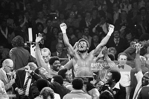 Handlers raise Leon Spinks on their shoulders in triumph at the Las Vegas Hilton Pavilion after a split decision wins him the world heavyweight title...
