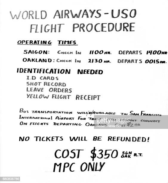 A handlettered sign posted in a US Navy barracks at Da Nang Air Base in South Vietnam in 1970 advertises World Airways/USO flights from Saigon...