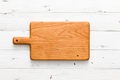 Handmade cherry wood chopping board on white board, handmade wood cutting board