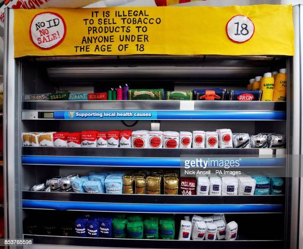 Handmade felt packets of cigarettes inside The Cornershop in Wellington Row Bethnal Green east London an art installation by textile artist Lucy...