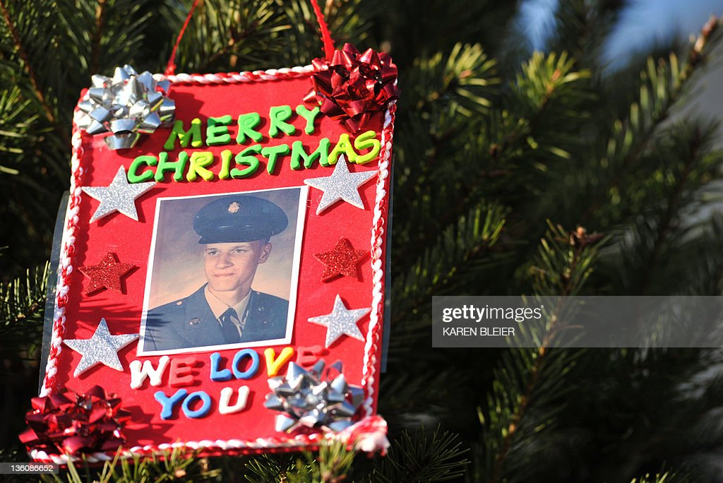 A Handmade ornament with the photo of a fallen soldier adorns the Vietnam Veterans Memorial Christmas Tree December 19, 2011 in Washington, DC. The Vietnam Veterans Memorial Fund (VVMF) Honored veterans and active-duty military personnel during its 15th Annual Christmas Tree Ceremony at The Wall. AFP PHOTO/Karen BLEIER