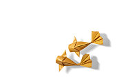 Handmade paper craft gold color origami koi carp fish on white background.