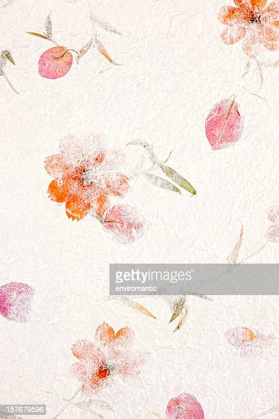 Handmade recycled flower and leaf paper background.