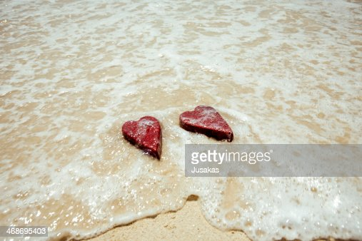 Handmade shabby Red heart sand background : Stock Photo