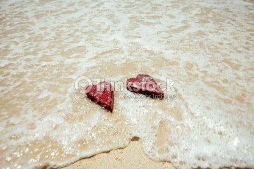 Handmade shabby Red heart sand background : Stock Photo