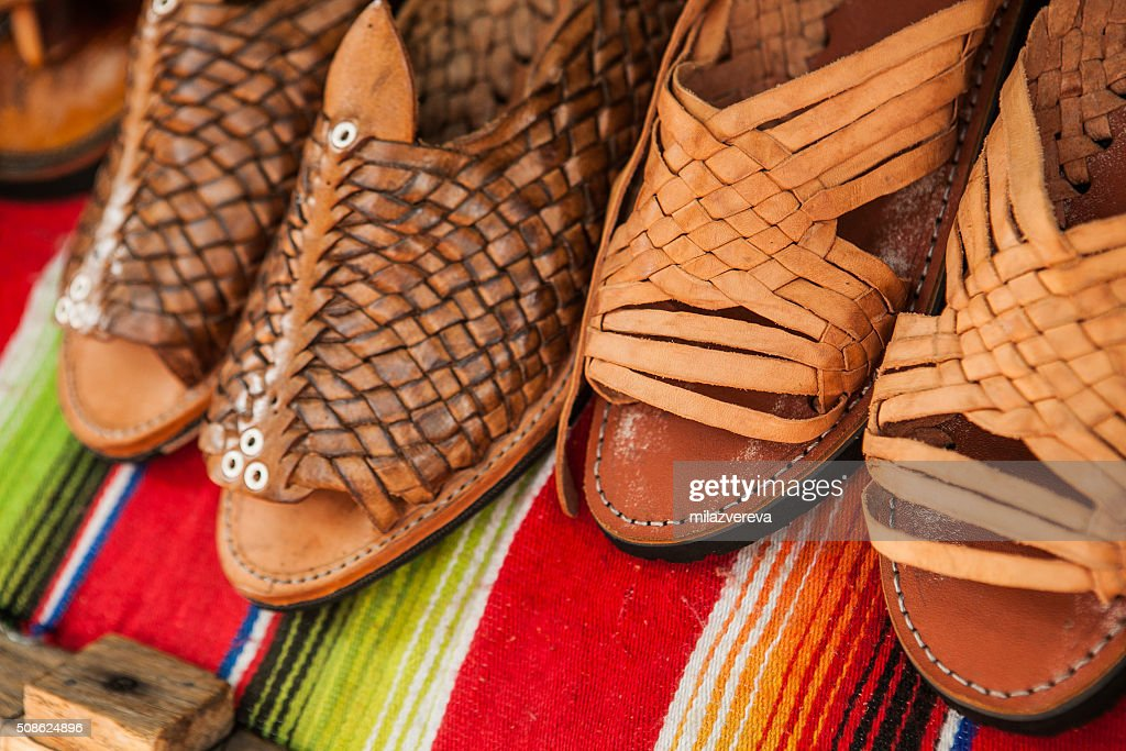 Handmade shoes made of leather in Mexican market : Stock Photo