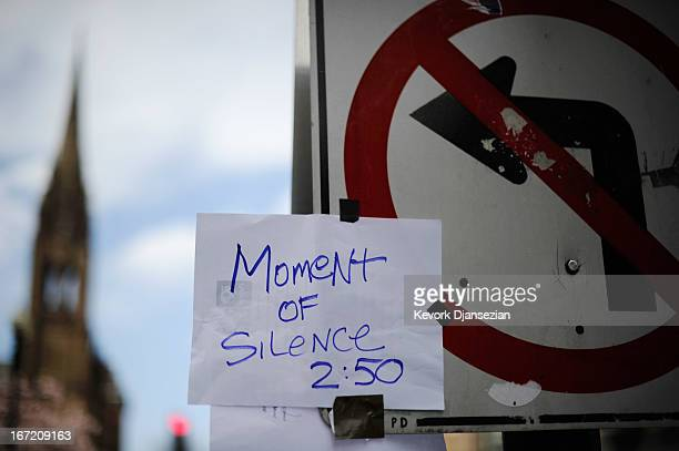 A handmade sign hangs on a trqaffic sign near the Boston Marathon finish line on one week anniversary of the bombings on April 22 2013 in Boston...