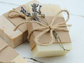 Handmade spa lavender soap on vintage wooden background. Soap making. Soap bars. Spa, skin care. Gift wrapping.