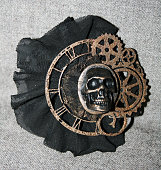 Handmade steampunk brooch with a skull, bronze decorative elements and black lace
